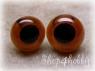 Глаза коричневые со зрачком 5-14 мм